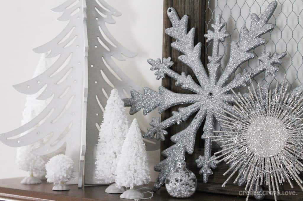 all of the silver snowflakes were ornaments on the 80 off shelf at joann fabric i purchased the white flocked christmas village trees and the white wooden - Joann Fabrics Christmas Decorations
