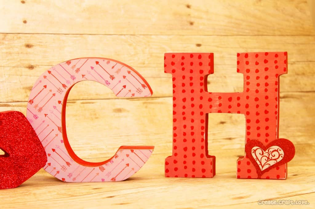 Mod Podge Wooden Letters for Valentine's Day at createcraftlove.com #valentinesday #modpodge #woodenletters
