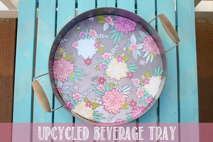 All you need is a little scrapbook paper and mod podge to create this Upcycled Beverage Tray via createcraftlove.com #upcycle #summer #modpodge