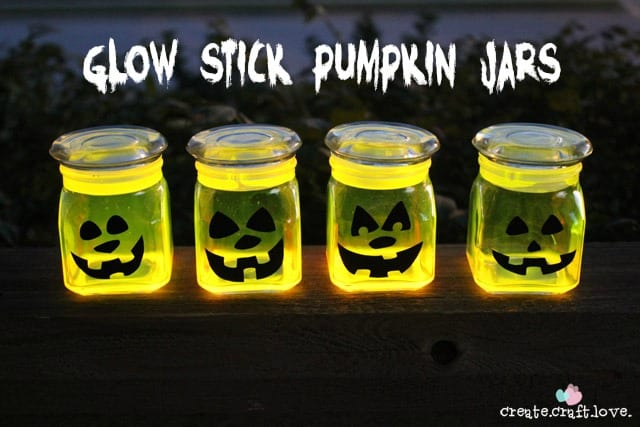 these glow stick pumpkin jars will be the talk of the neighborhood on halloween night - Glow Stick Halloween Decorations