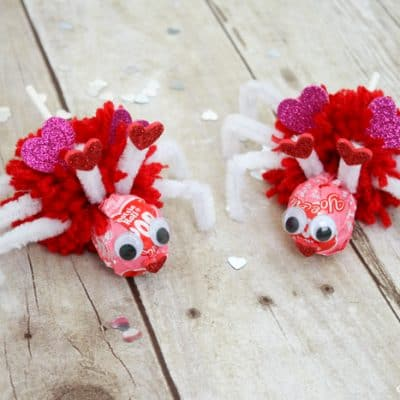 Using Valentine Tootsie Pops, I created these Love Bug Pops for the kiddo to pass out to his classmates! via createcraftlove.com #valentinesday #pompom #valentineideas #kidsproject