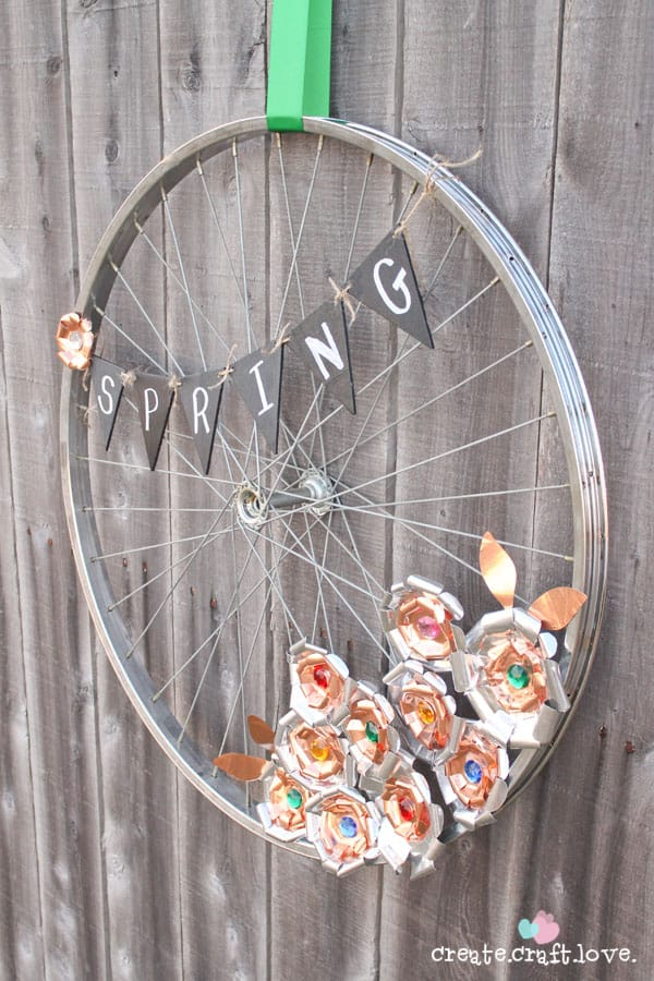 Create this Metal Flower Bicycle Wheel Wreath with a little help from the Cricut Explore!  #explorecricut #wreath #spring #decor