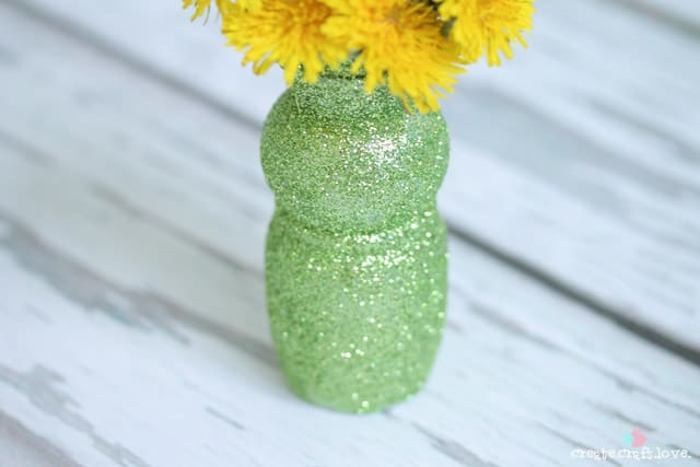 Upcycle an old yogurt cup to create these upcycled Bud Vases! via createcraftlove.com