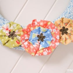 Vintage Scrap Wreath made from left over scrap fabric! via createcraftlove.com #wreath #fabric #summer