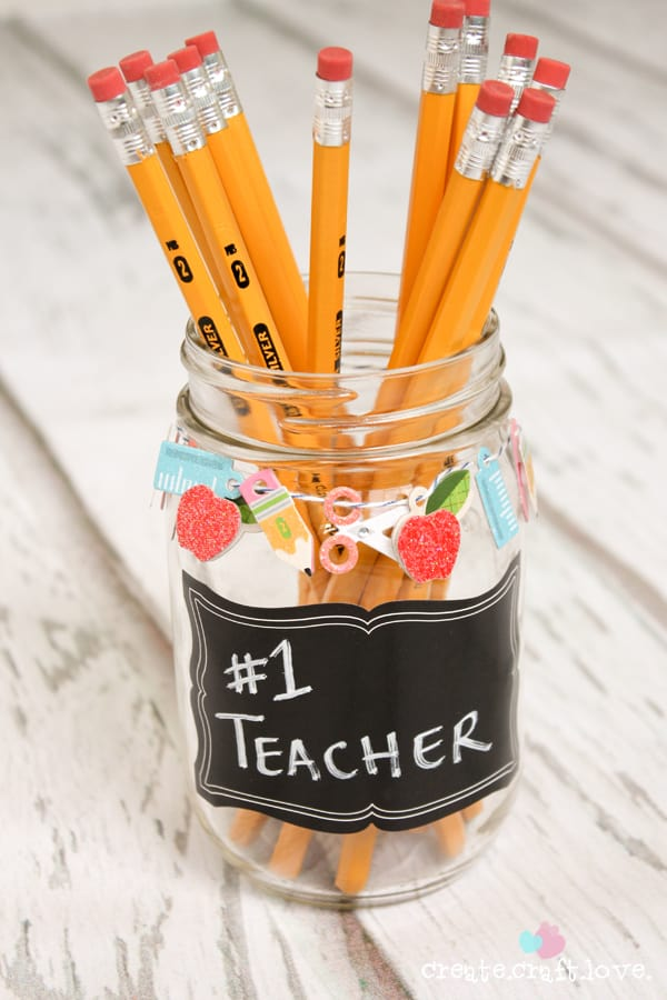 Grab some scrapbook embellishments, a mason jar and some candy to create this Mason Jar Gift for Teacher's Appreciation Week! www.createcraftlove.com