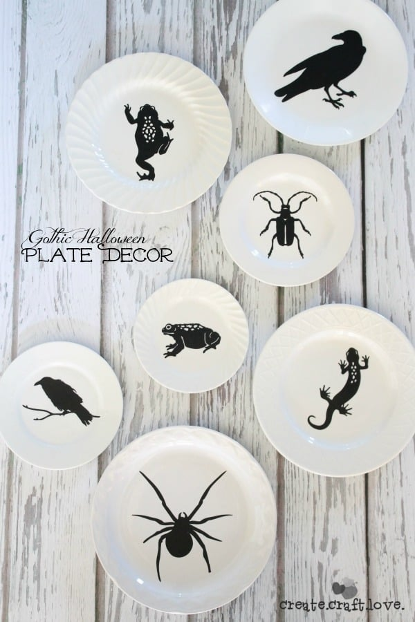 I threw some black silhouettes on these beautiful white vintage plates to create this Gothic Halloween Plate Decor!  via createcraftlove.com