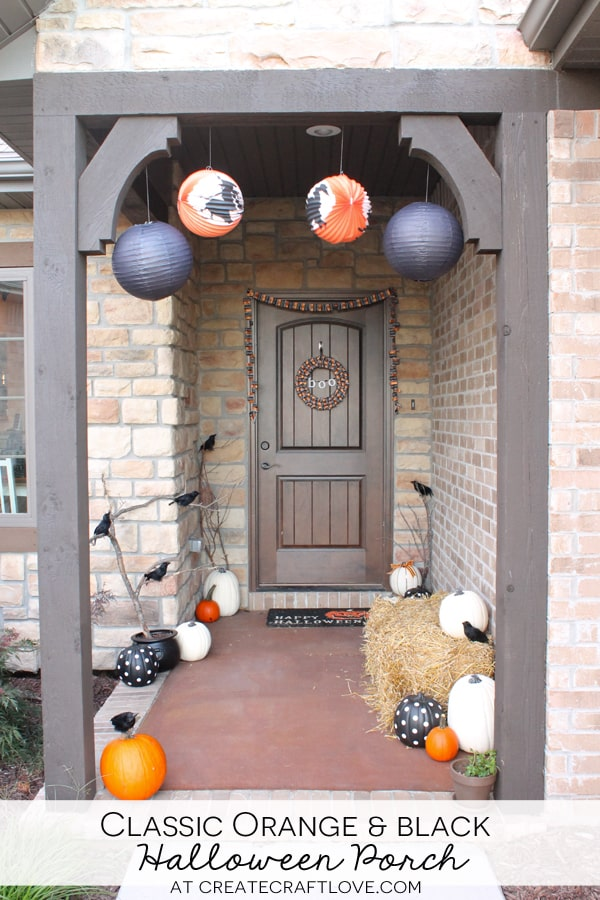 This Classic Orange and Black Halloween Porch will definitely put you in the Halloween spirit! via createcraftlove.com #spon