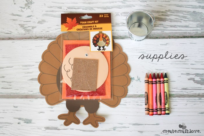 This Turkey Crayon Caddy makes an adorable centerpiece at the kid's table and costs less than $3 to make! via createcraftlove.com #fallharvestideas