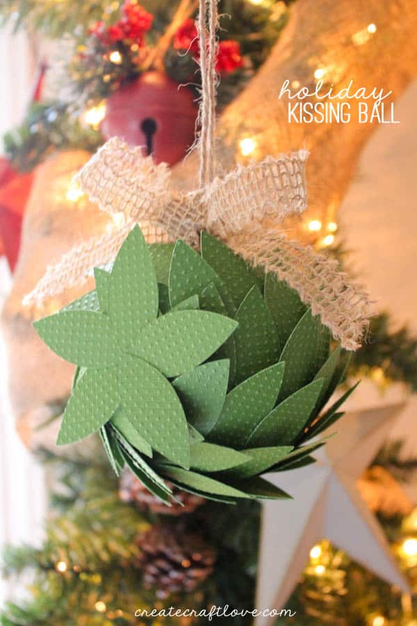 Add a little more to your Christmas decor with this Holiday Kissing Ball tutorial! via createcraftlove.com
