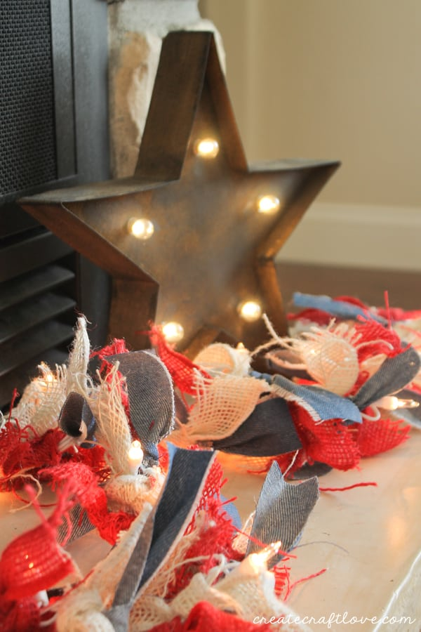 This Denim and Burlap Lighted Garland adds a touch of Americana this Fourth of July! via createcraftlove.com