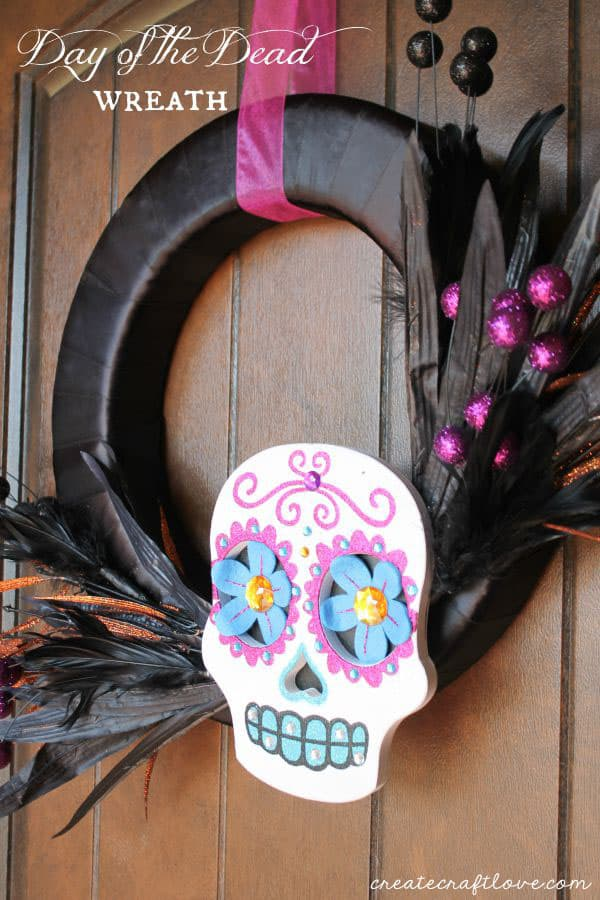 Create this bright and colorful Day of the Dead Wreath in less than 15 minutes! via createcraftlove.com