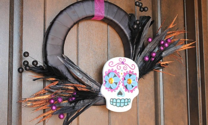 Create this colorful and bright Day of the Dead Wreath in under 15 minutes! via createcraftlove.com