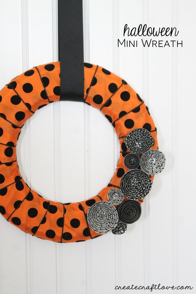 This Halloween Mini Wreath sports the traditional orange and black with but stays trendy with polkadots and stripes!