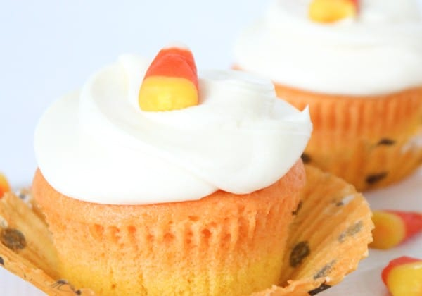 You don't have to be a fan of candy corn to love these vanilla Candy Corn Cupcakes! via createcraftlove.com