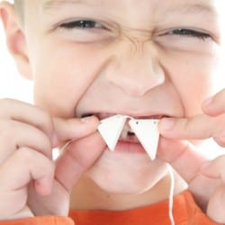 This DIY Fang Necklace is a fun kid's craft for Halloween! via createcraftlove.com