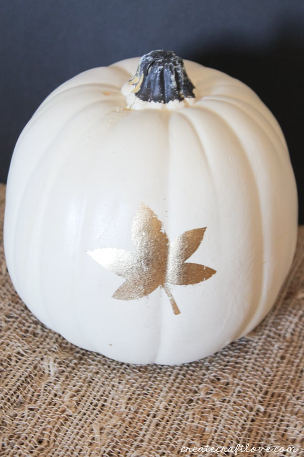 You will love how pretty these Gold Leaf Stenciled Pumpkins look!! via createcraftlove.com