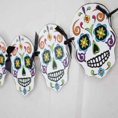 This Sugar Skull Garland is easy to make and I love how it turned out! via createcraftlove.com