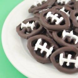 These bite sized chocolate covered football pretzels make perfect Super Bowl Party Treats! via createcraftlove.com