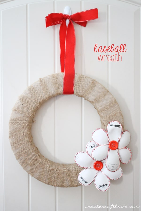 This Baseball Wreath complete with baseball flowers is the best way to welcome spring (training)!