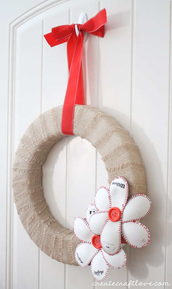 This Baseball Wreath complete with baseball flowers is the best way to welcome spring (training)! via createcraftlove.com