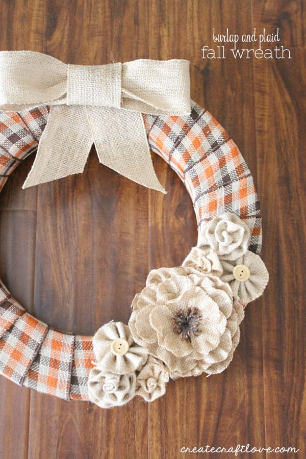This Burlap and Plaid Fall Wreath is the perfect way to greet guests this autumn!