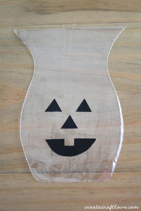 add jack o lantern face to bag