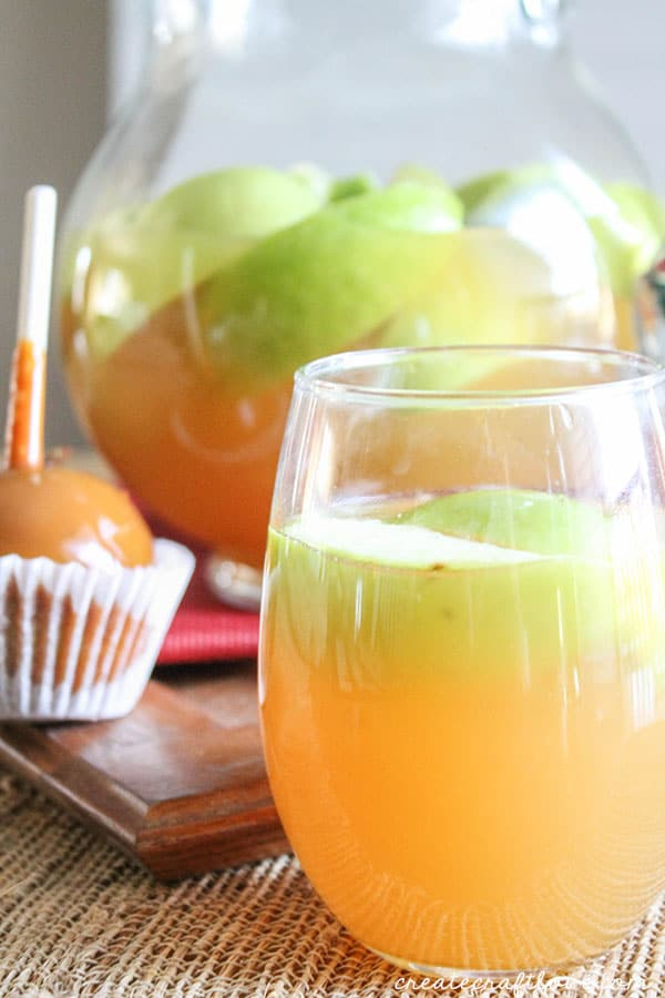 This Caramel Apple Sangria mingles your favorite fall flavors into one amazing adult beverage!