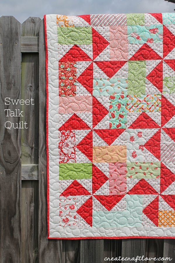 This Sweet Talk Quilt is made up of fun pinwheel blocks and bright colors! via createcraftlove.com