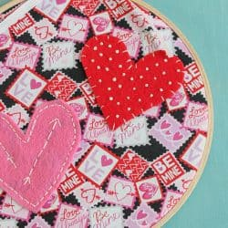 What do you get when you combine Valentine fabric, felt and embroidery floss? This adorable Valentine Hoop Art! via createcraftlove.com