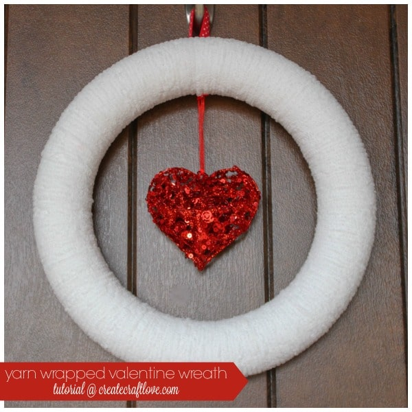 This Yarn Wrapped Valentine Wreath is easy to make and can be used for other seasons! via createcraftlove.com
