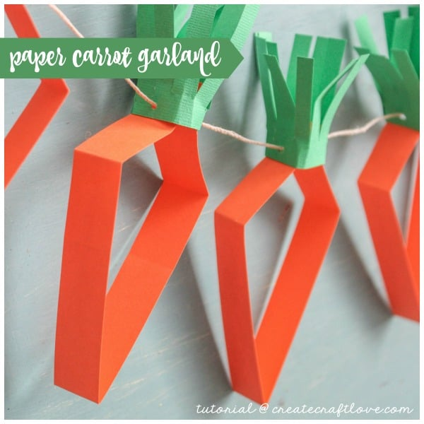 This Paper Carrot Garland is a great kids craft and can be done without a cutting machine! via createcraftlove.com