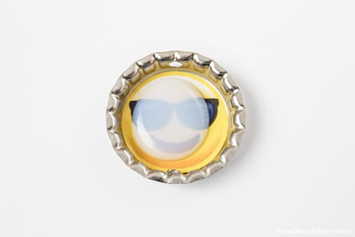 Use dimensional magic to seal the sticker in the center of the bottlecap