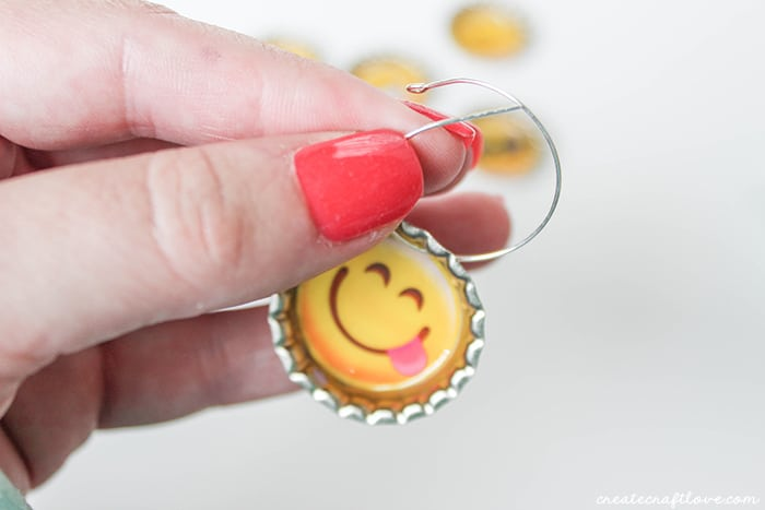 Slide a hoop earring through the hole at the top of the drink tag