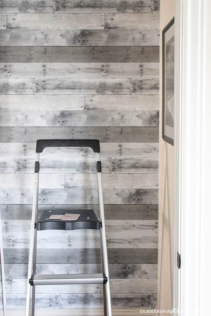 Pallet plank wall with wallpaper!