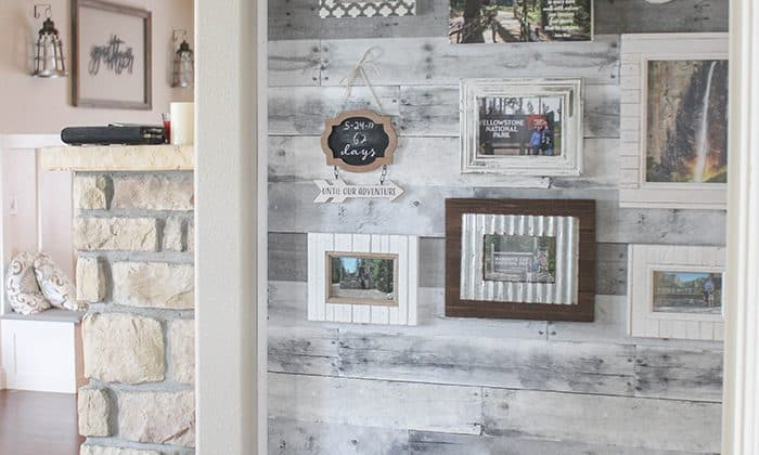 Use adhesive wall paper to create a statement Faux Pallet Wood Wall!