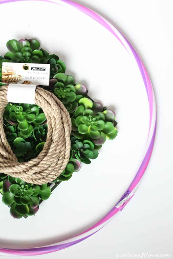 All you need to create this Succulent Hoop Wreath is a hula hoop, rope and fake succulents!