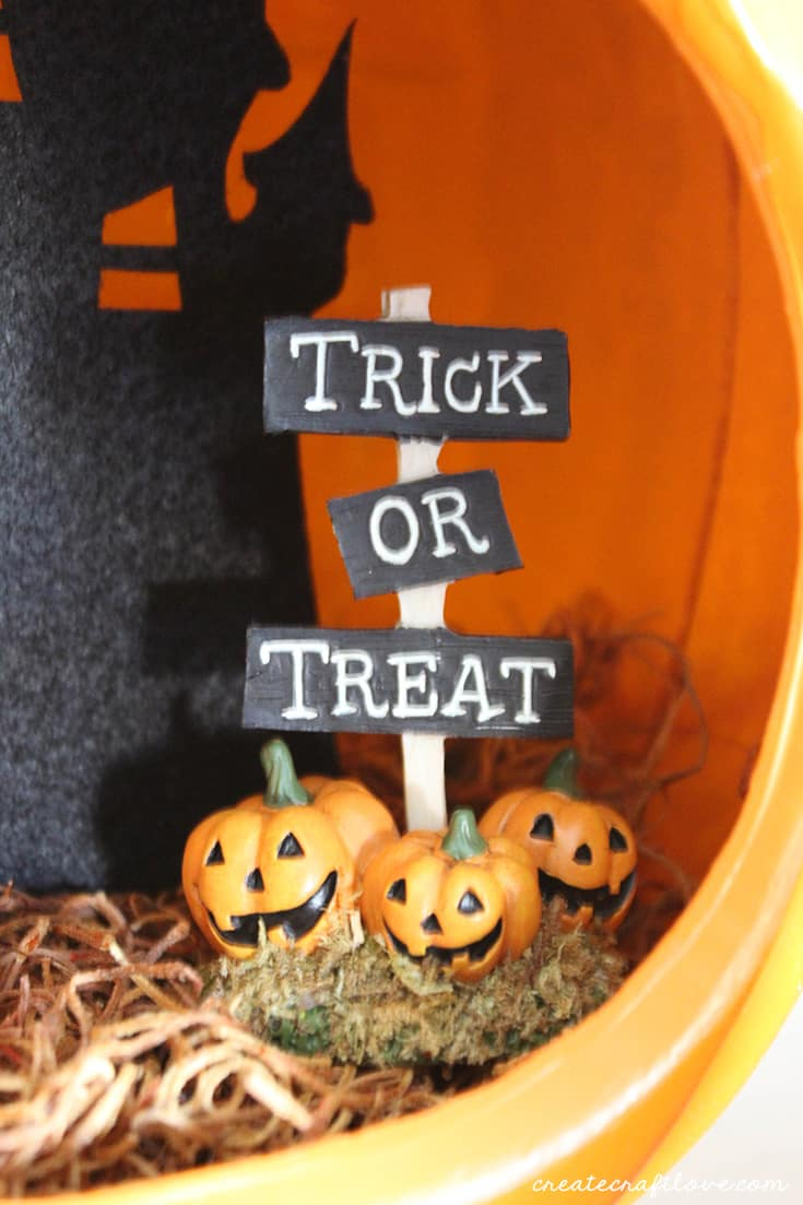 Add Halloween figurines to your pumpkin diorama!