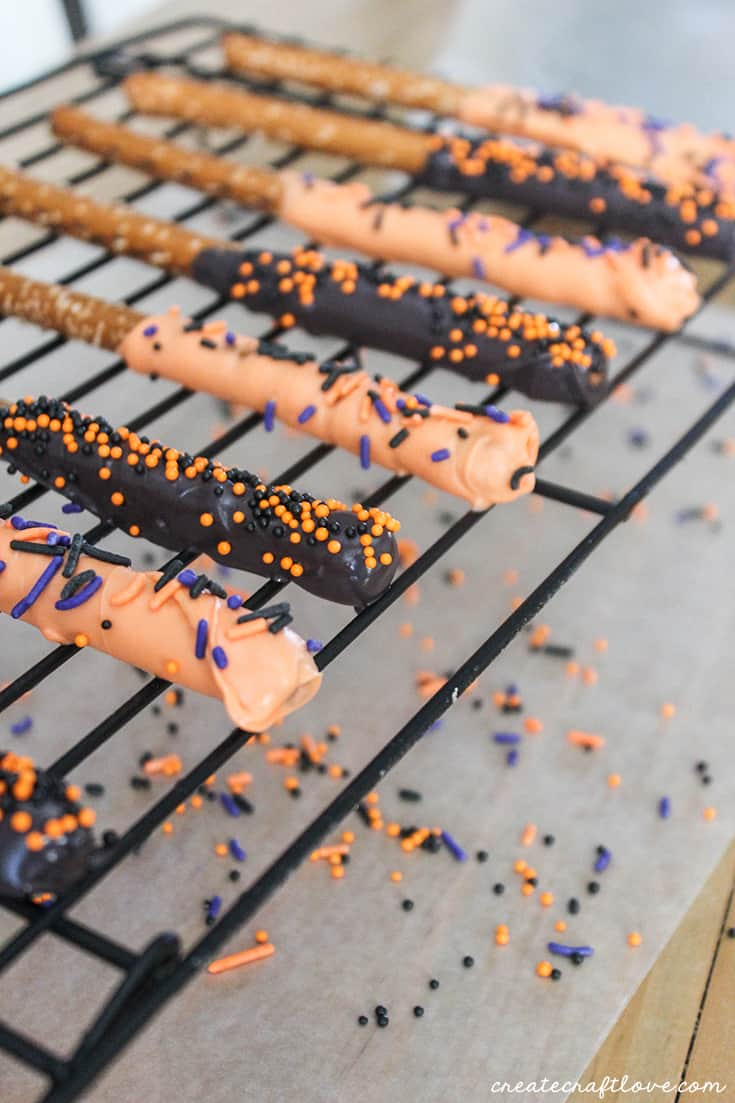 Add sprinkles to your Halloween Chocolate covered Pretzels!