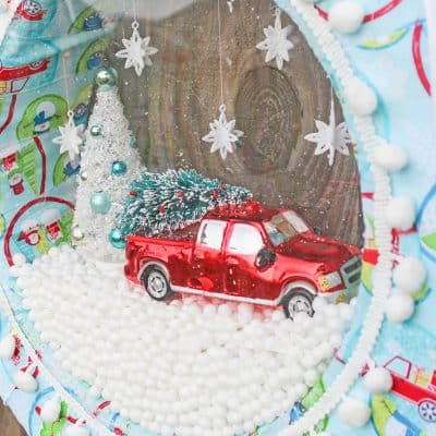 Your guests will go nuts for this snow globe wreath!