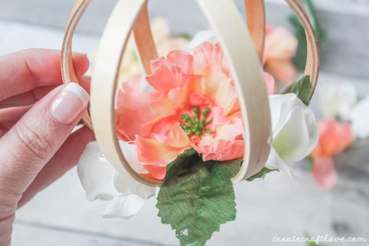 embroidery hoop floral orb adding flowers