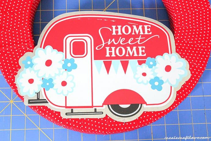 glue tin camper decoration to happy camper summer wreath