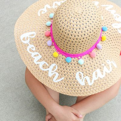 Protect your face from the sun's harmful rays with our trendy DIY Beach Hat with Iron On Vinyl!