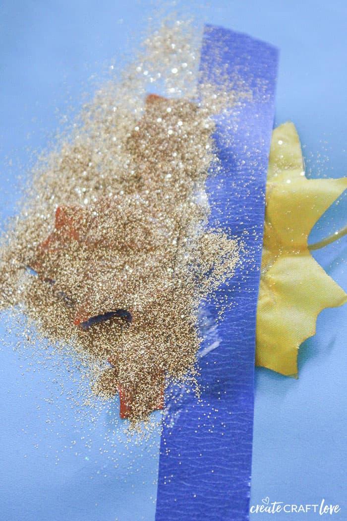 add glitter to create the glitter dipped mod podge