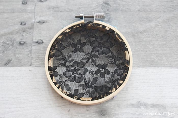 trimmed black lace for spider web embroidery hoop art