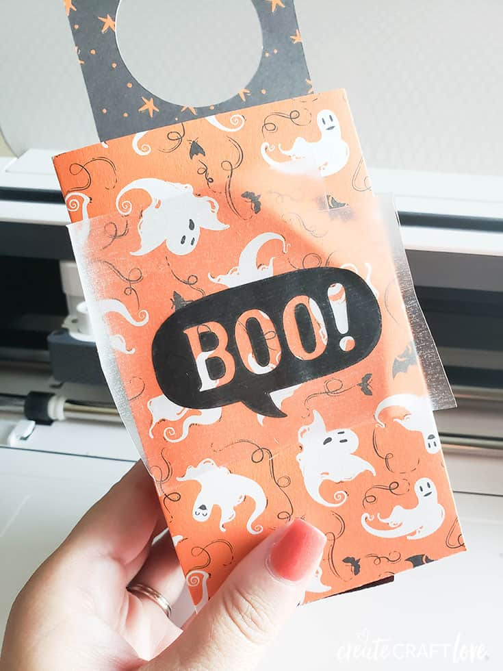 Transfer tape to apply the vinyl to the front of your Halloween Door Hanger