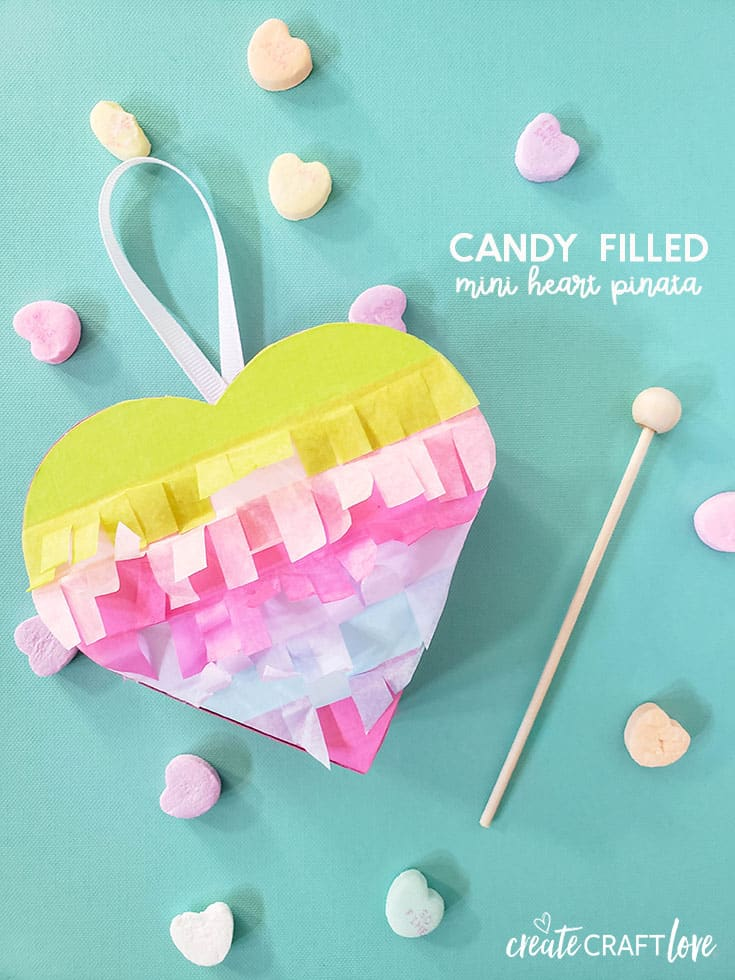These Mini Heart Pinatas are sure to bring a smile to any face! #cricut #papercrafts #pinatas #valentinesday #hearts