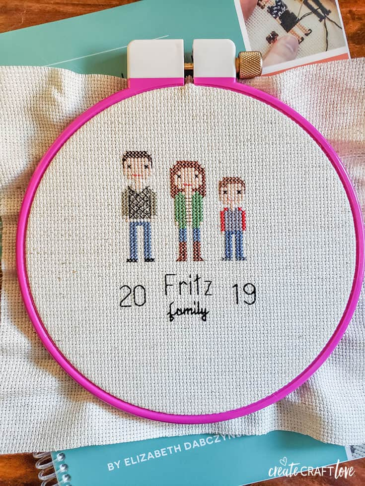 family cross stitching with stitch people