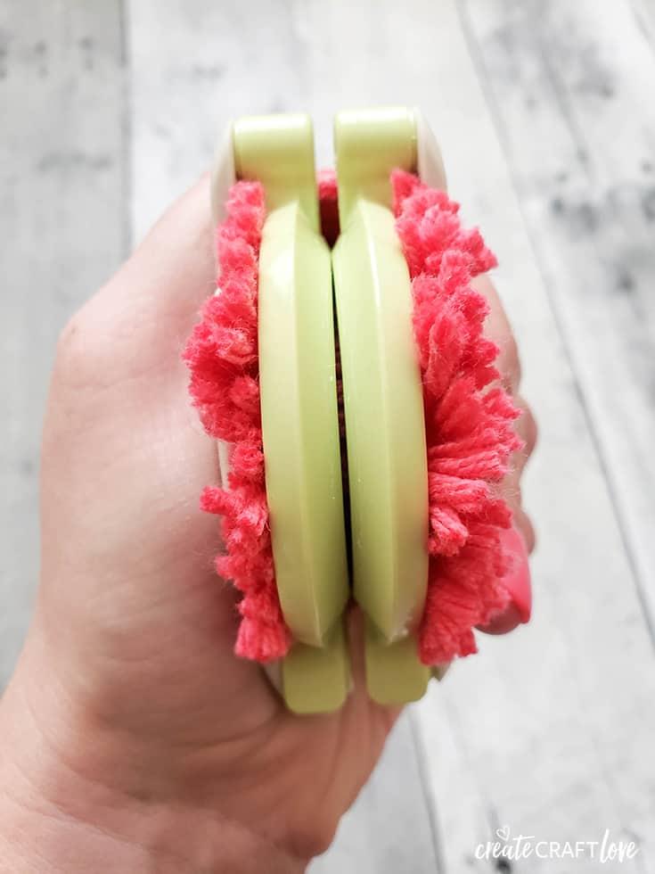 cutting yarn for flamingo pom pom garland