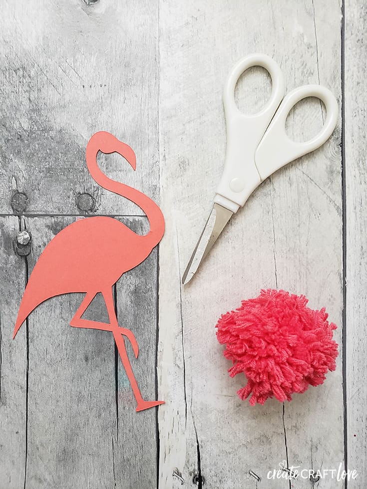 prepping flamingo pom pom garland