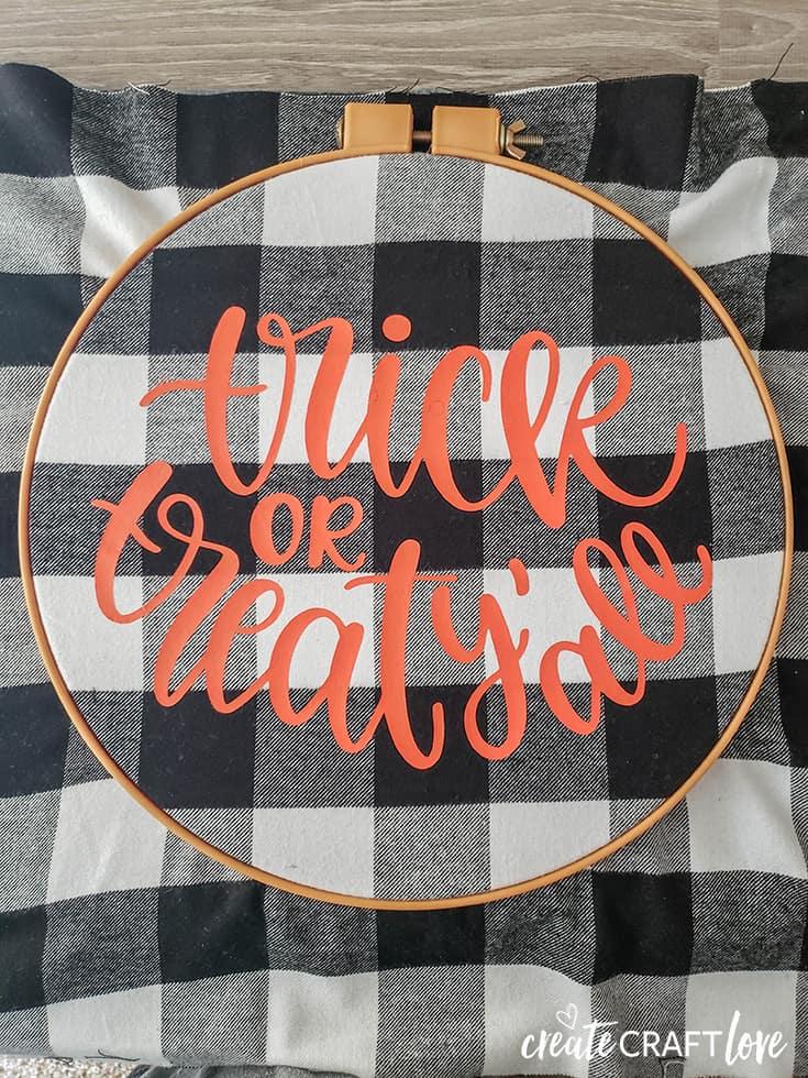 arrnage fabric in embroidery hoop halloween wreath